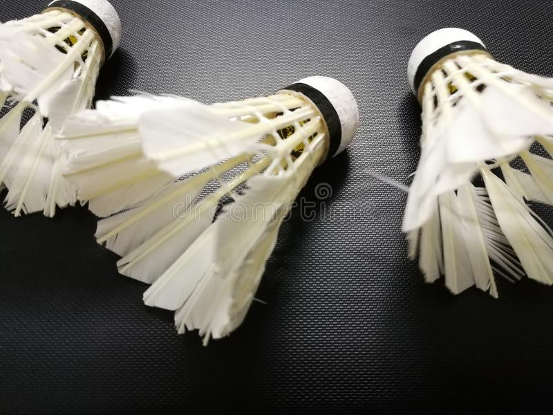 White badminton Shuttlecock Birdie isolated on black background. Concept about something changed, being useless. A lightweight object that is conical in shape royalty free stock photos