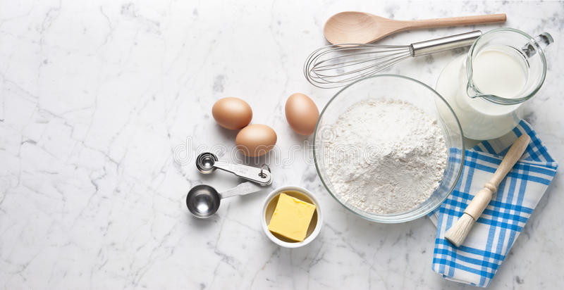 White Marble Baking Cooking Banner Background. Various food ingredients and cooking utensils on a white marble background from overhead stock photography