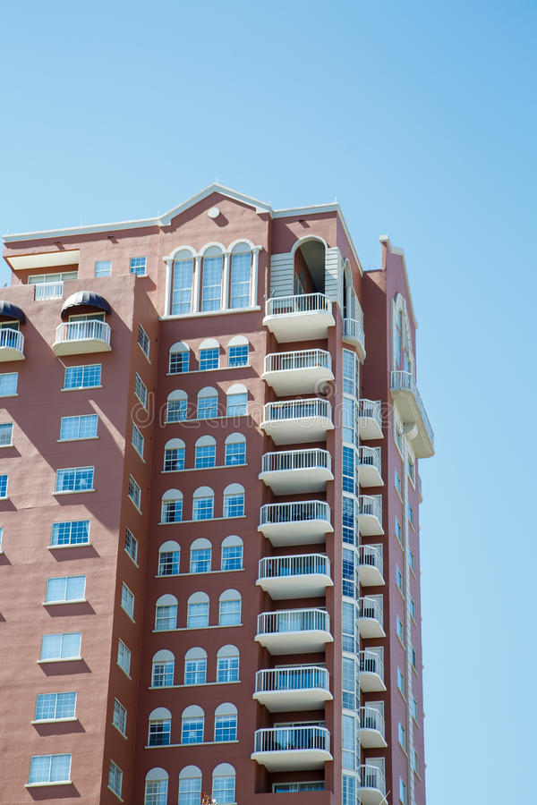 Free White Balconies On Brown Condo Tower Stock Image - 33594931