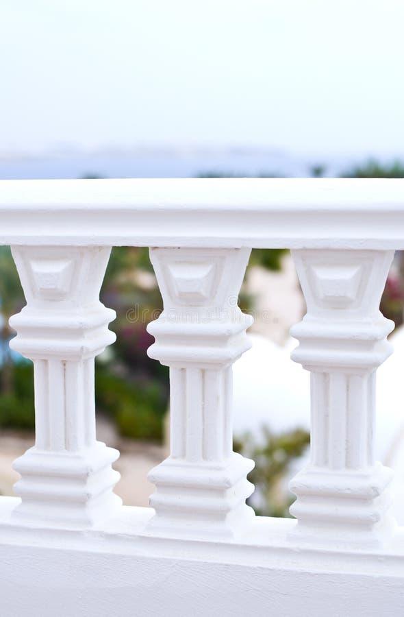 White balcony railing. A closeup view of the details of a white balcony railing royalty free stock photo