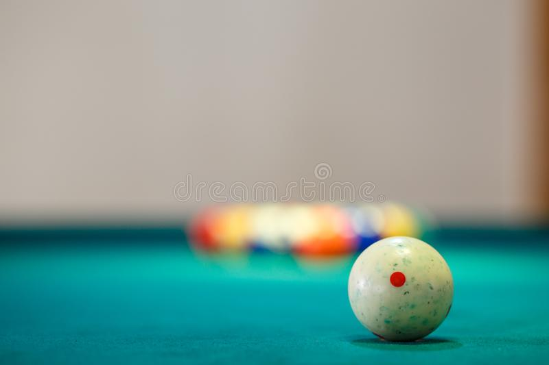 White ball on billiard table at start of the game. White ball on billiard table at the start of the game. Snooker game concept background stock image