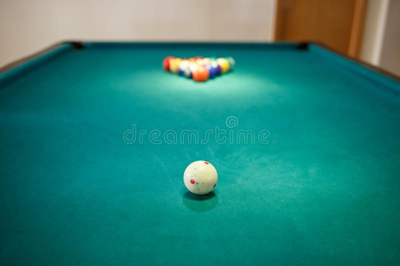 White ball on billiard table at start of the game. White ball on billiard table at the start of the game. Snooker game concept background stock photos