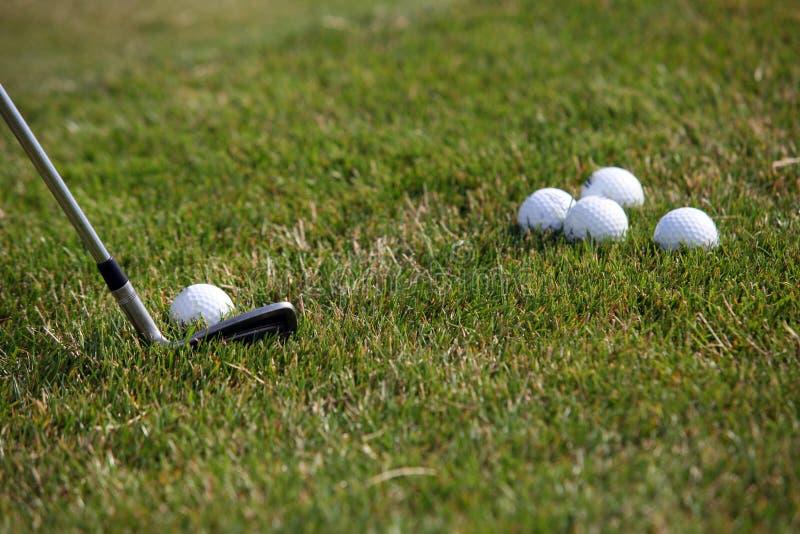 Golf tournament - golf balls and iron stick stock images