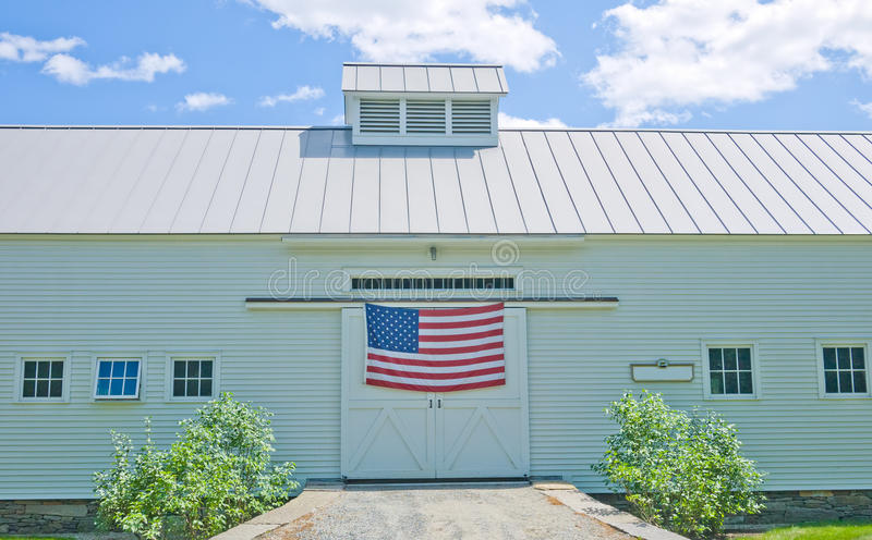 White Barn with American Flag royalty free stock photos