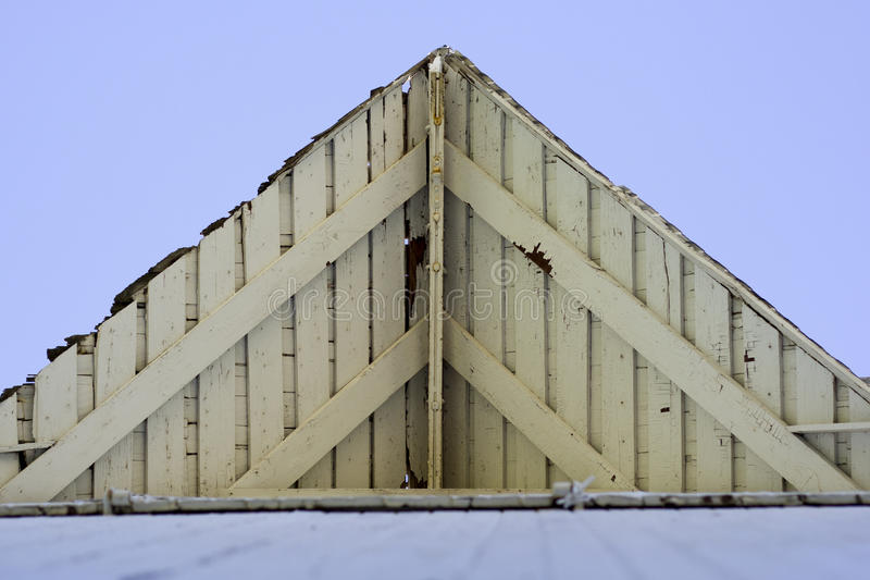 White Barn wood roof. Peeling, white barn wood pointed roof stock photography