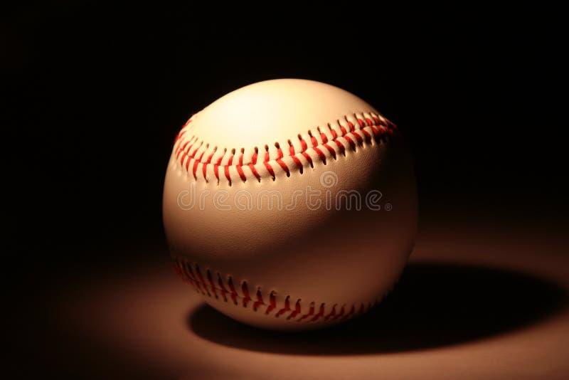 White baseball on dark background royalty free stock image