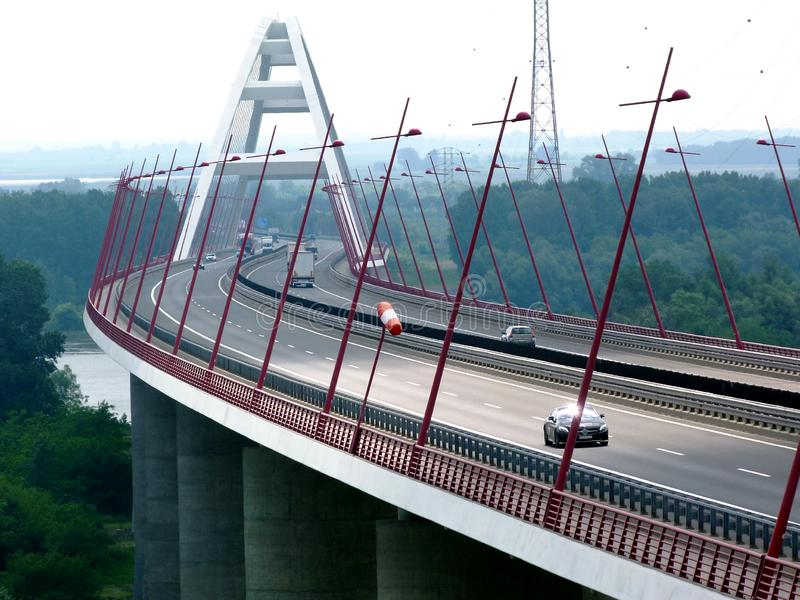 White basket handle bridge and car traffic on diminishing perspective view. Diminishing perspective and panoramic view of white basket handle bridge and car stock images