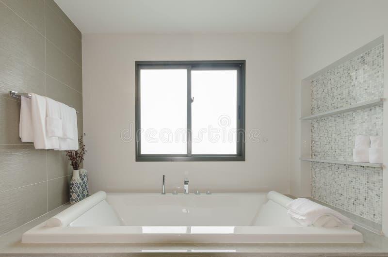 White bathroom toilet with bath tub. In modern house royalty free stock photo