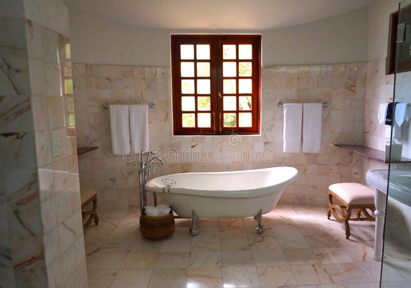 White Bathtub On White Tile Bathroom Near Brown Framed Clear Glwindow Public Domain Image