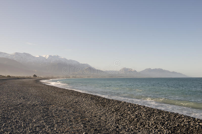 Download White Beach And Blue Sea In Winter, New Zealand Stock Photo - Image: 67107495