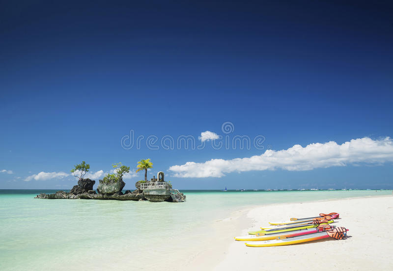 white beach and christian shrine and paddle boats on boracay tropical island in philippines royalty free stock photo