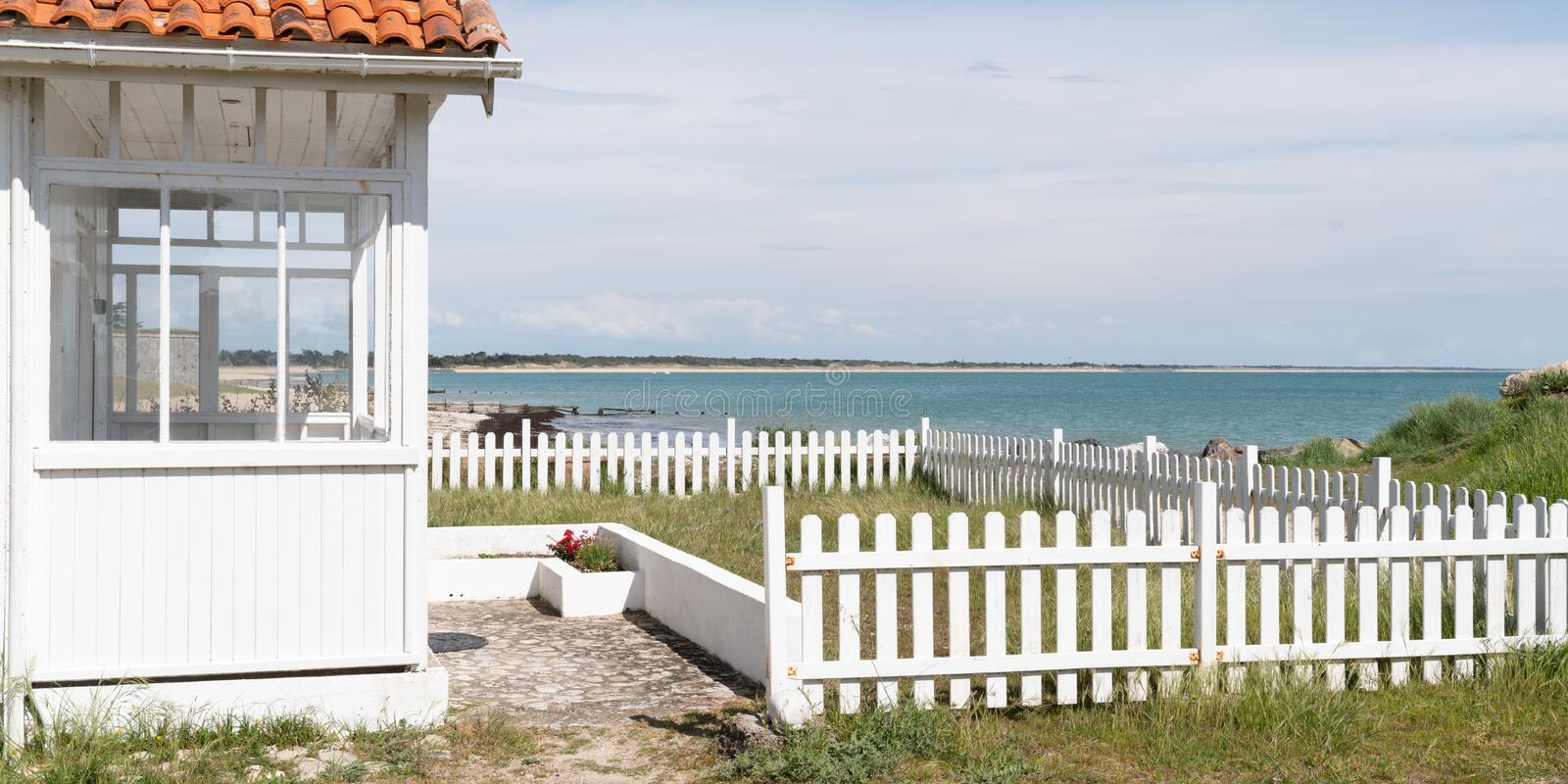 White beach house front of arcachon Bassin in cap ferret in France in web banner template stock images