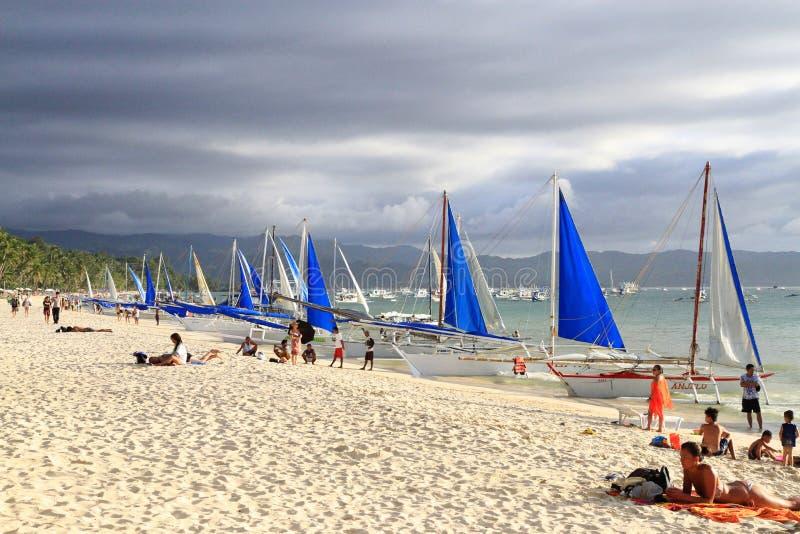 Sailboats on the White Beach with a clouded sky, Boracay royalty free stock photos