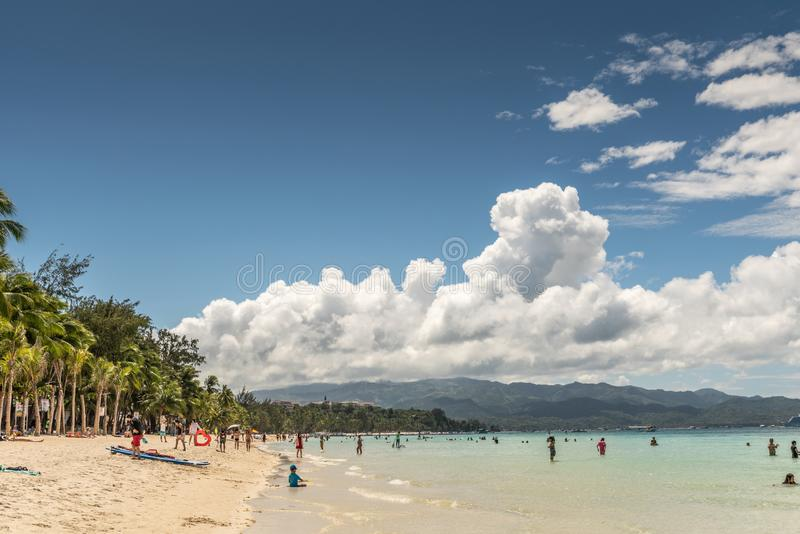 White beach sand, palm trees and Malay Island, Balabag, Boracay, Philippines royalty free stock images