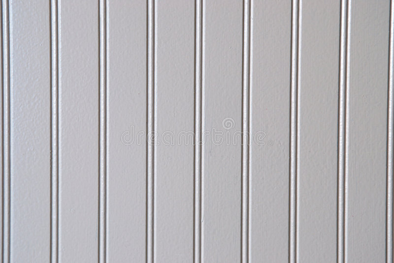 White Bead board. Close up view of bead board wainscoting with vertical tongue-and-groove lines stock photo