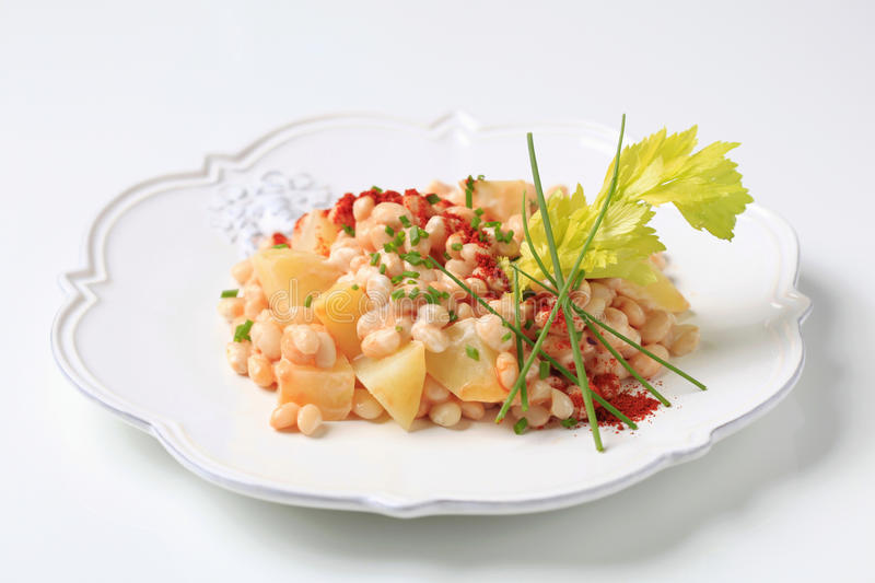 White bean salad. White bean and potato salad sprinkled with chives royalty free stock photos