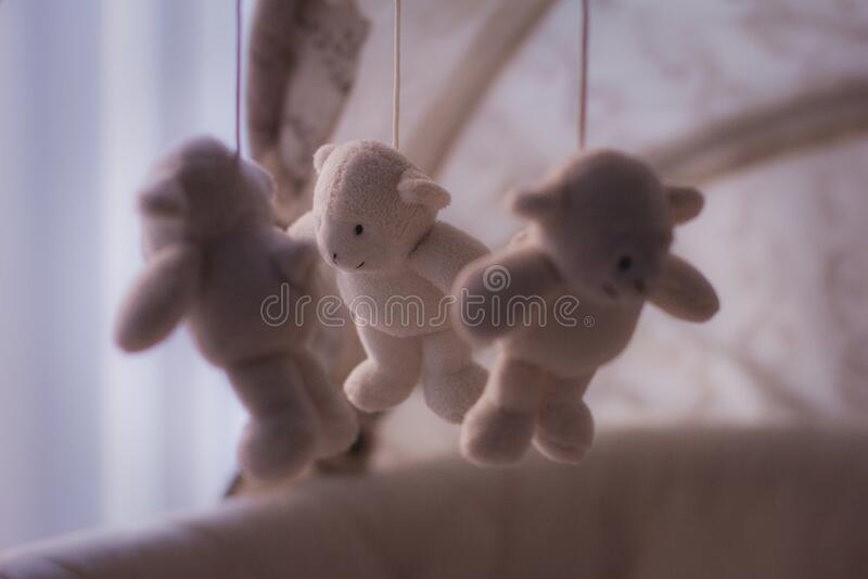 White Bear Plush Toy on Baby Mobile stock image