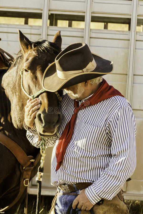 White Bearded Cowboy by his Horse royalty free stock photo