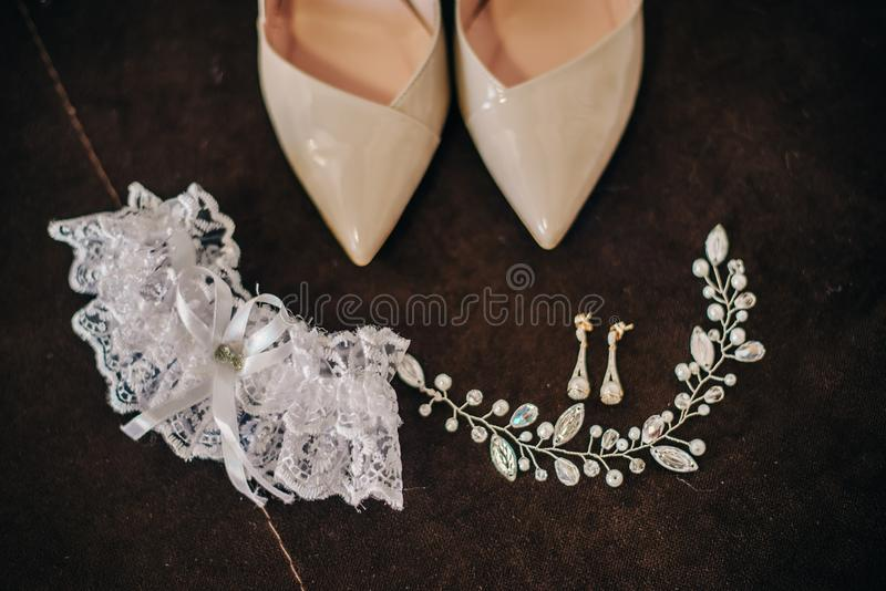 Beautiful shoes for the bride with earrings hair ornament stock photography