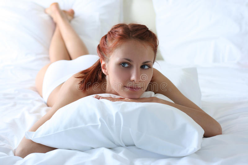 Download On white bed stock photo. Image of female, healthcare - 14621156