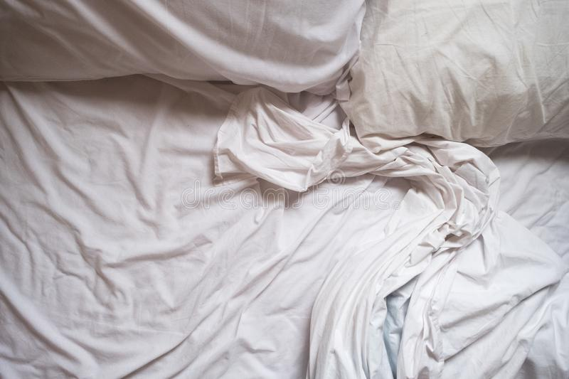 White Bed maid-up with wrinkled bed sheets after sexual night stock photos