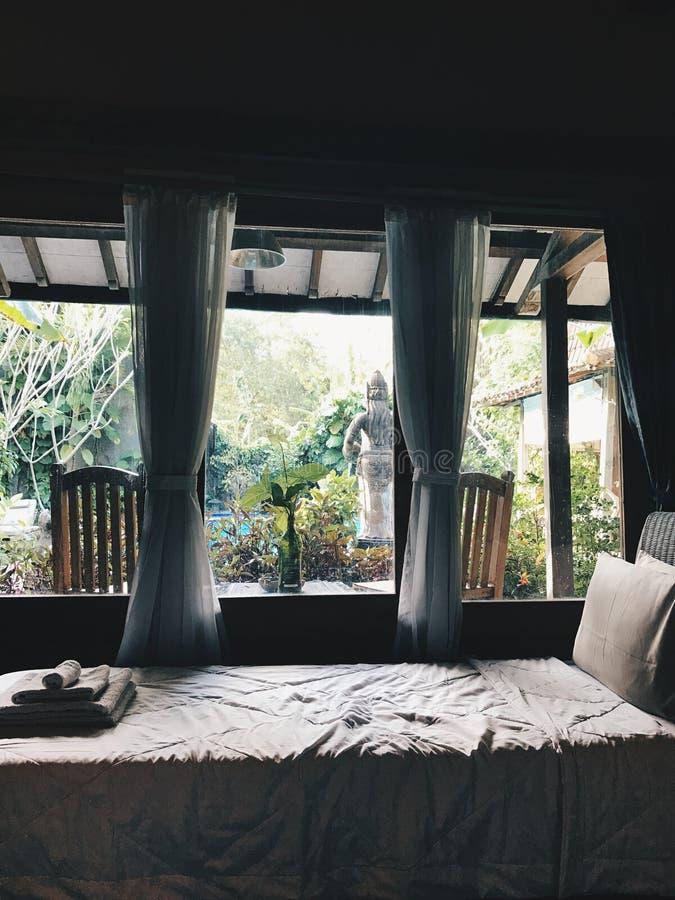 White Bed Near Window royalty free stock photo