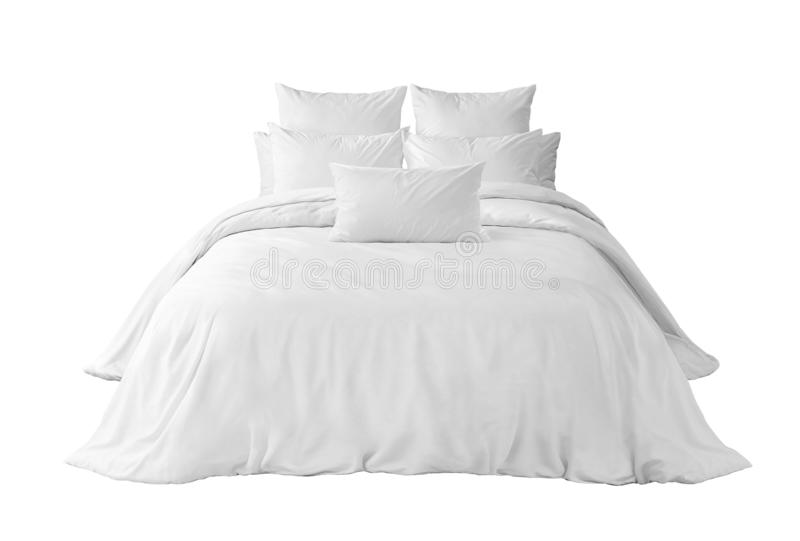 White bed with pillows an duvet isolated royalty free stock photography