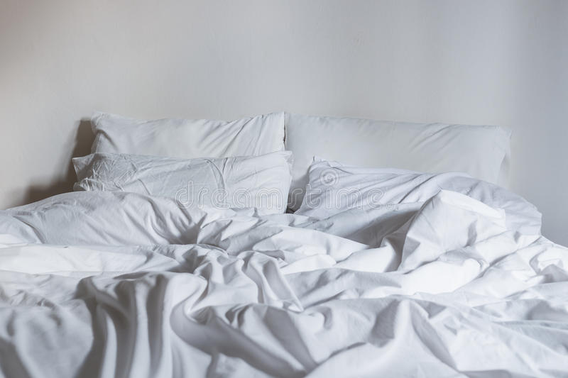 White Bedding Sheets And Pillow, Messy Bed Concept Stock ...