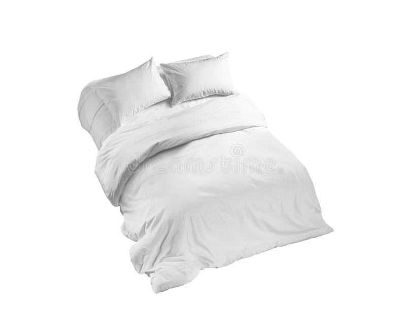 White bedlinen on a bed isolated, top view royalty free stock photos