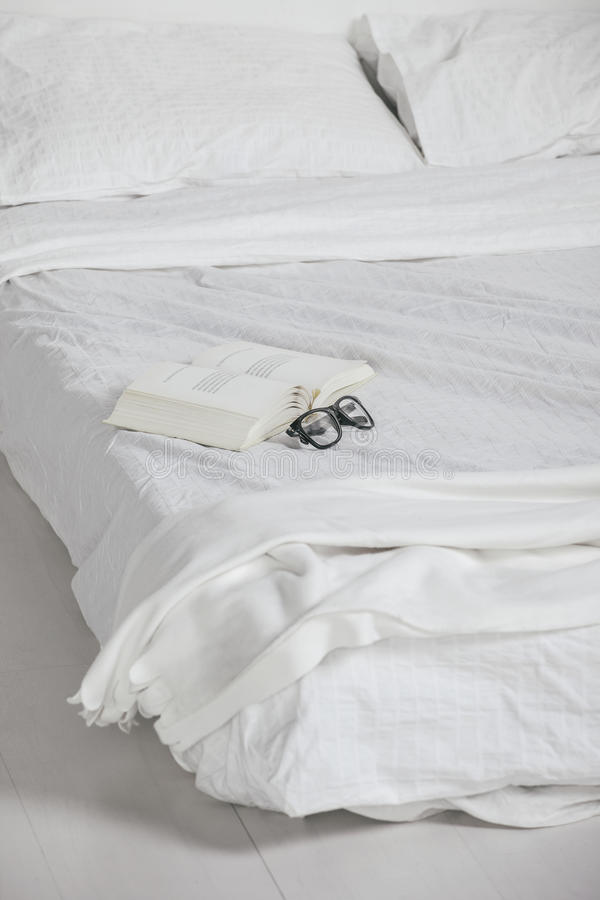 Download The White Bedroom. Closeup Of Old Book And Rimmed Glasses On Bed. Stock Photo - Image: 35868460