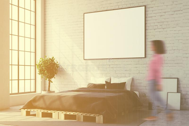 White bedroom corner, poster close up blur. White bedroom corner with a concrete floor, a master bed and a framed horizontal poster above it. A close up, a woman royalty free illustration