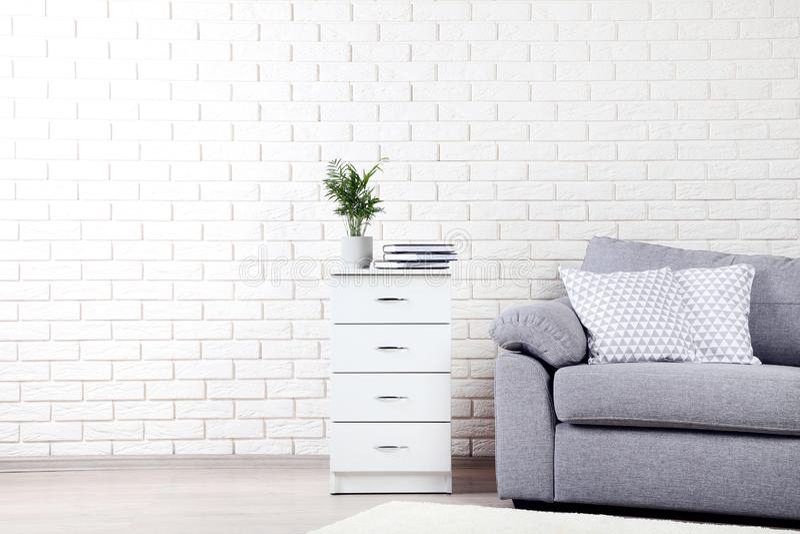 Bedside table near grey sofa royalty free stock photo