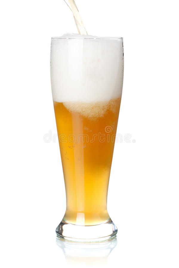 White beer is pouring into a glass from bottle. Beer collection - White beer is pouring into a glass from bottle royalty free stock image