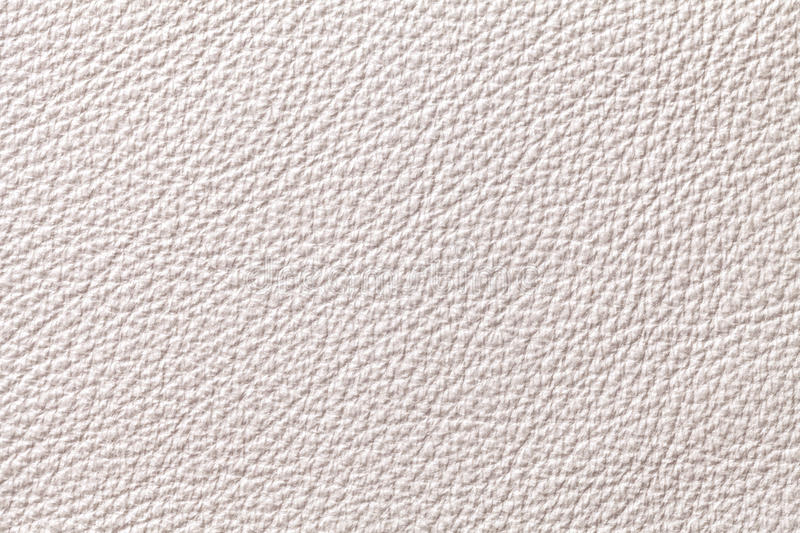 White beige leather texture background with pattern, closeup. White pearl leather texture background with pattern, closeup royalty free stock image