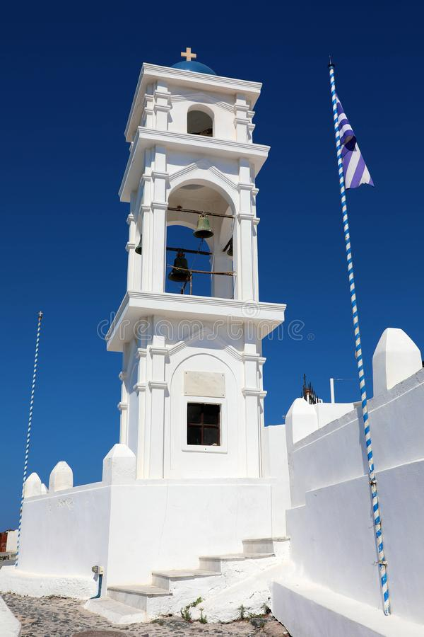 White bell tower with blue dome of Greek orthodox church in Thira, Santorini, Greece stock photography