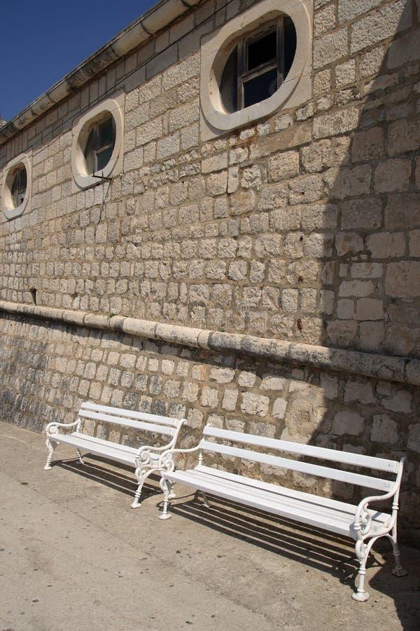 White benches stock photos