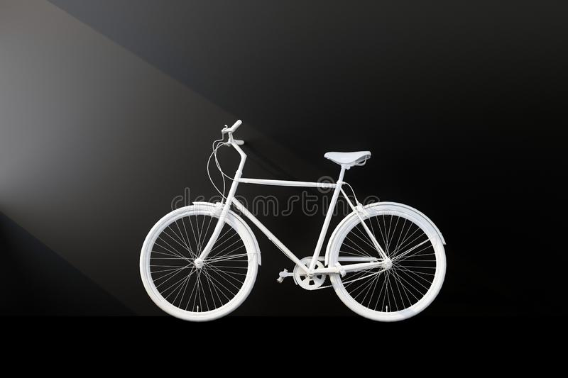 White bicycle with black wall royalty free stock photography