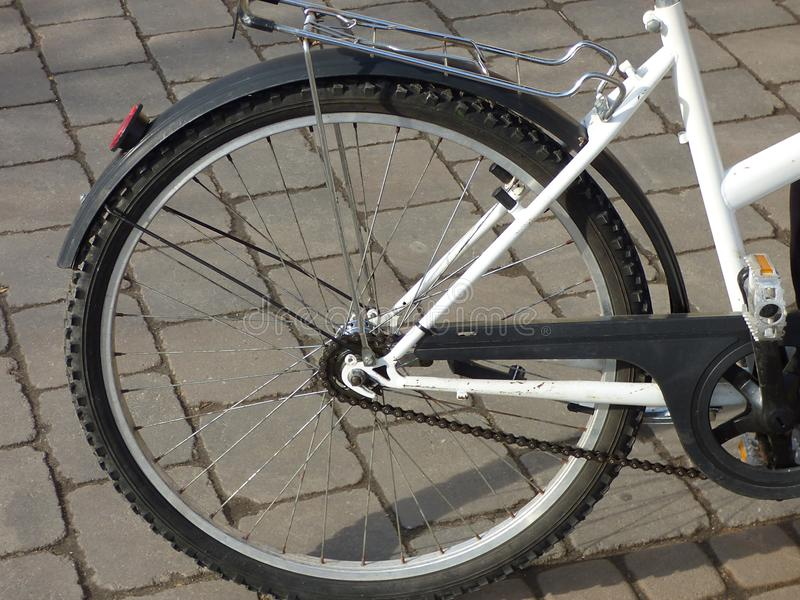 White bicycle tire rear wheel outdoor picture. Metal steel bike stock image