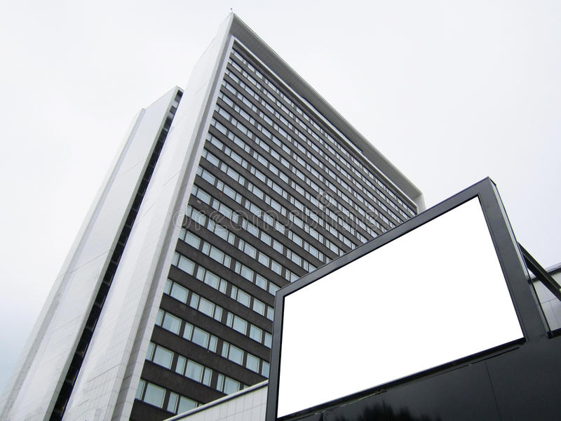 White billboard on the background of a skyscraper office building, mock up. White billboard on the background of a skyscraper office building, mock stock images