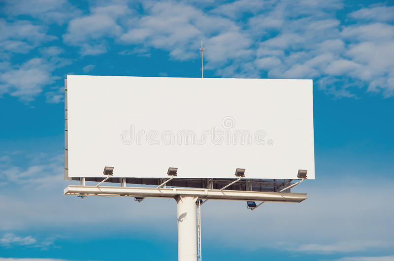 White billboard with cloudy sky on background royalty free stock photos
