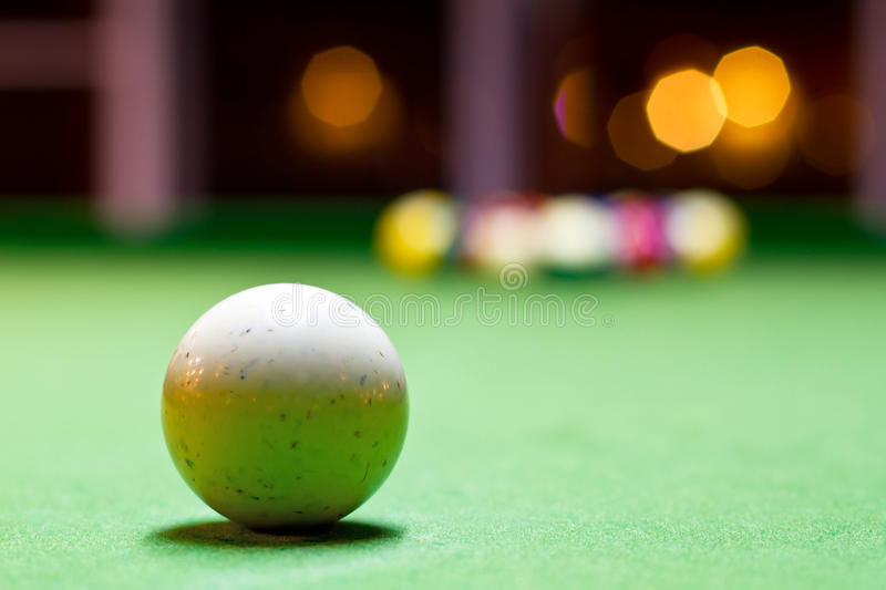 White billiard ball. On the pool table royalty free stock photos