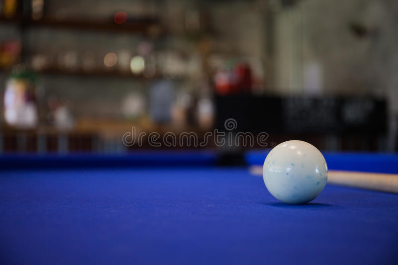White Billiard ball on blue pool table. A white Billiard ball on blue pool table royalty free stock images