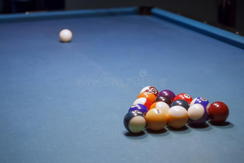 White billiard ball lying on the front of the. Pool ball set royalty free stock photography