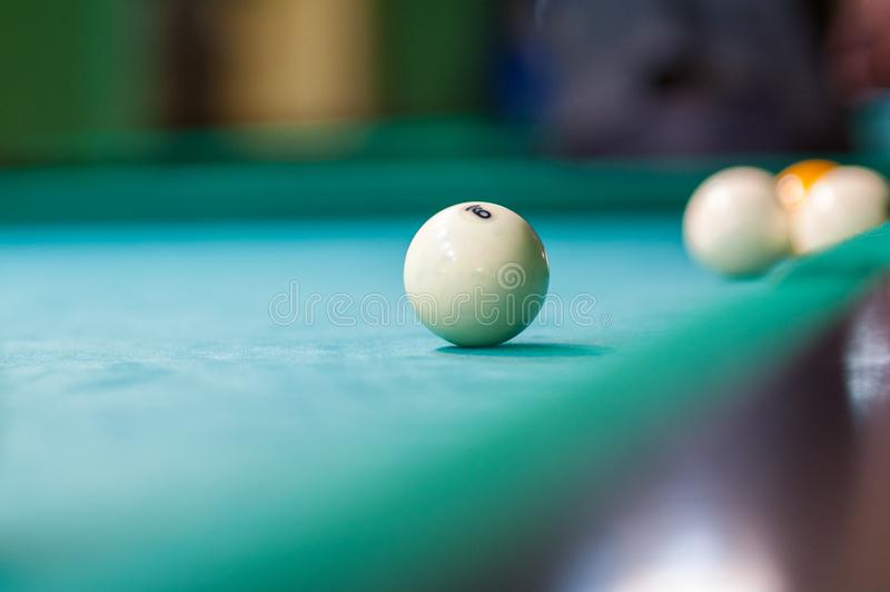 White billiard ball on the table, billiard club.  royalty free stock photography