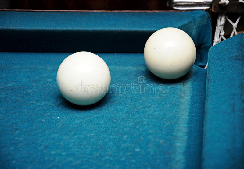 White billiard balls. Closeup white billiard balls near the pockets royalty free stock photo