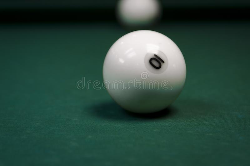 White billiard balls covered on a table with a green cloth stock images
