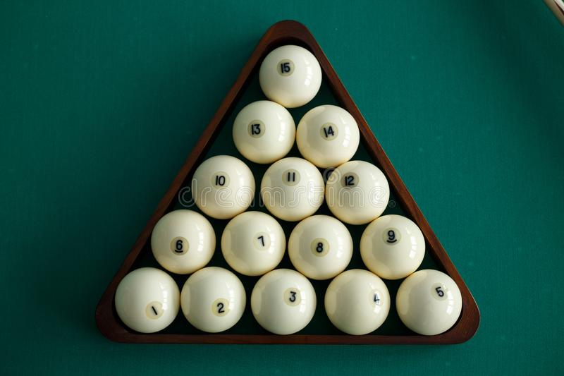 White billiard balls for Russian billiards, in a triangle on the table. Top view stock photos