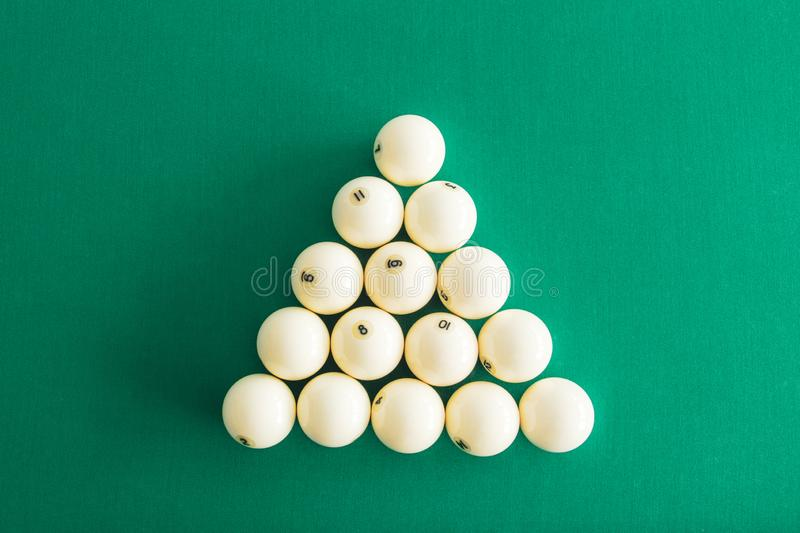 White billiard balls for Russian billiards, in a triangle on the table. Top view royalty free stock image