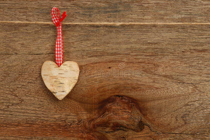 White Birch Love Valentine's heart hanging on wooden texture bac stock image