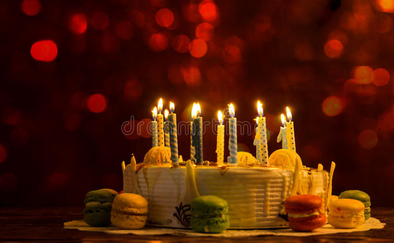 White Birthday Cake With Lots Of Burning Candles Glittering Red